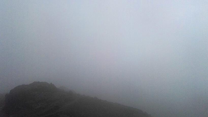 Inside a cloud on a mountain.