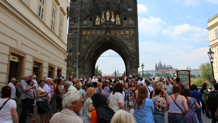 Tourist crowds on the way to Charles Bridge in Prague Old Town.