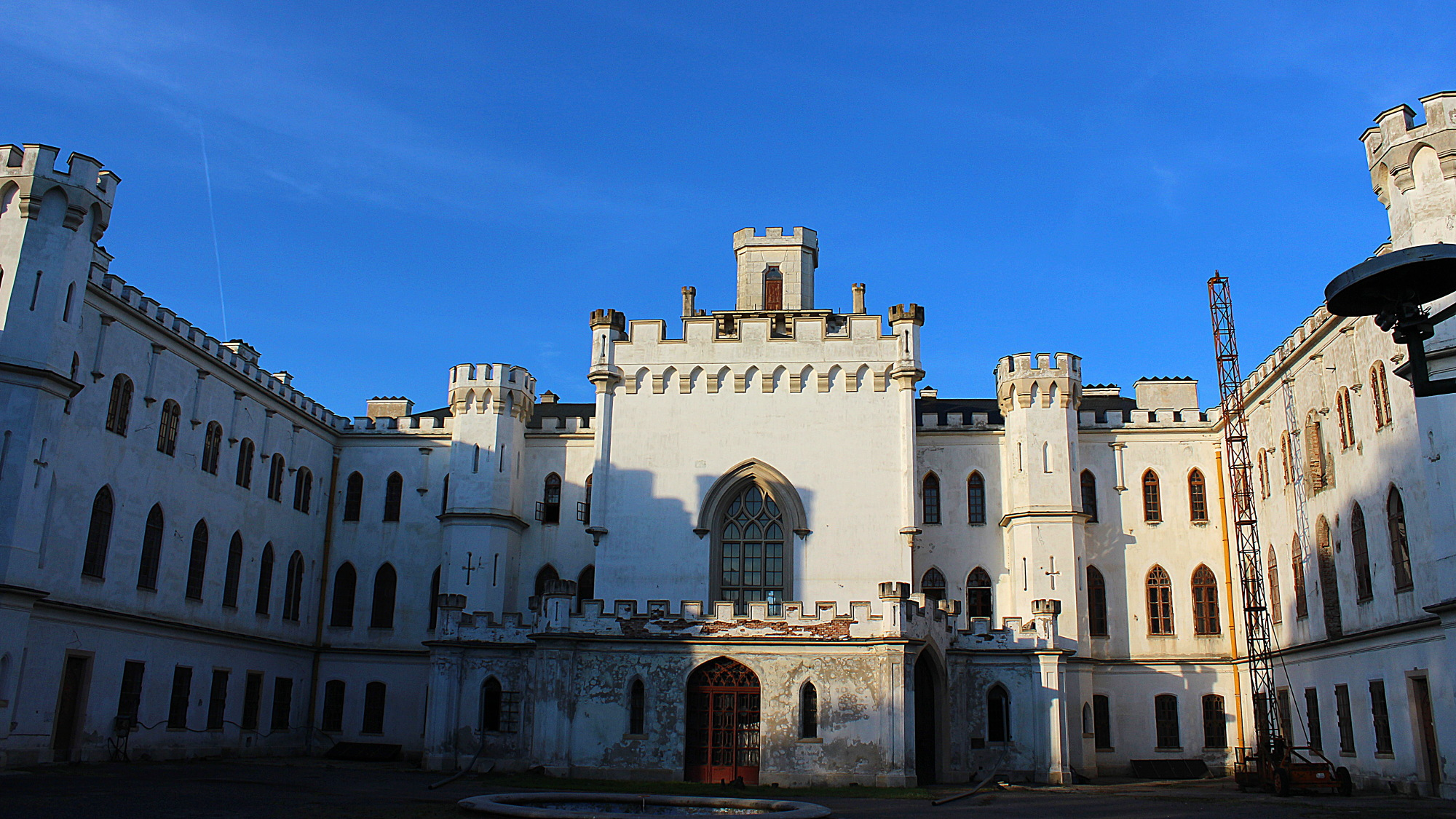 Abandoned Rusovce Mansion during sunset with blue sky.