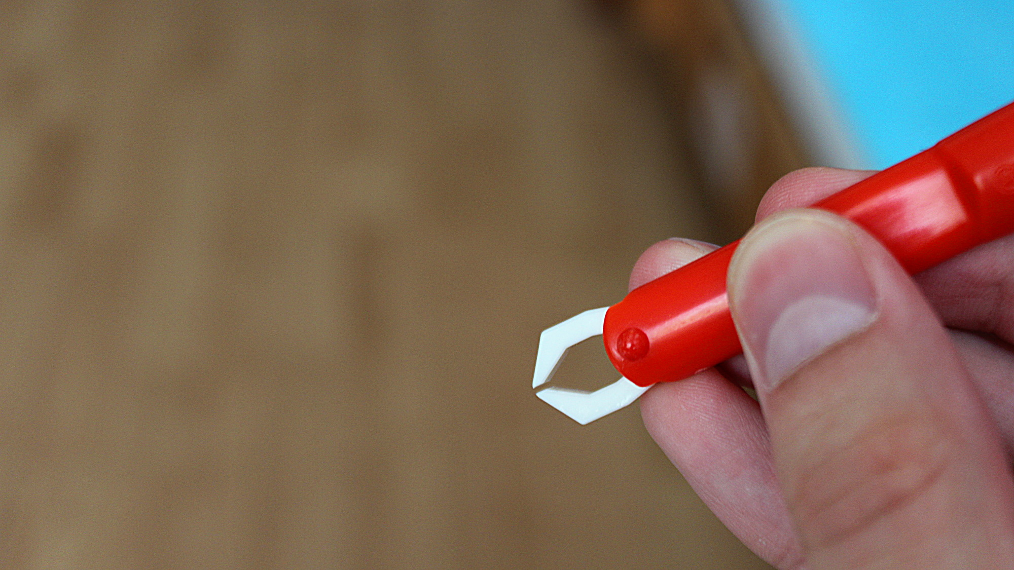 Red tick tweezers bought from pharmacy.