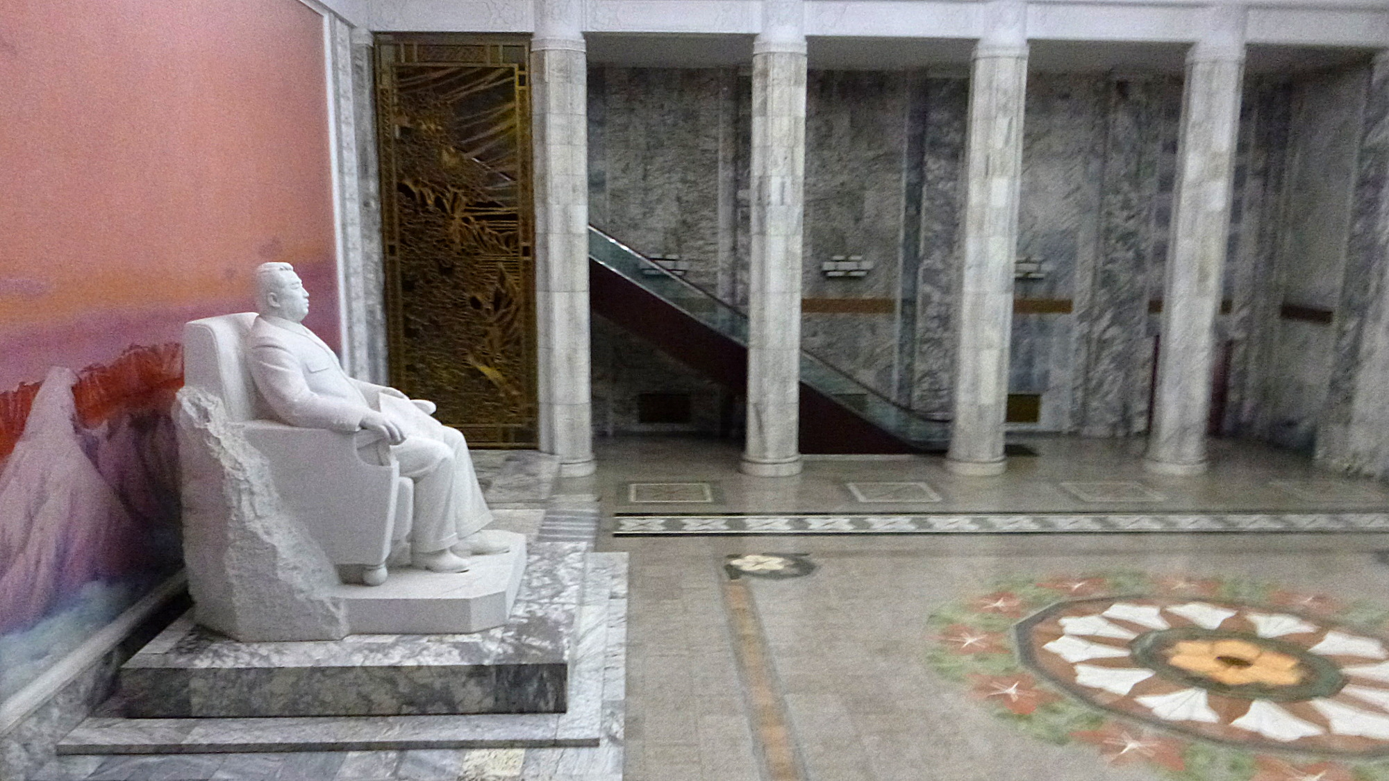 The entrance hall of the Grand People's Study House in Pyongyang wih marble floow and a statue of Kim Il-Sung.