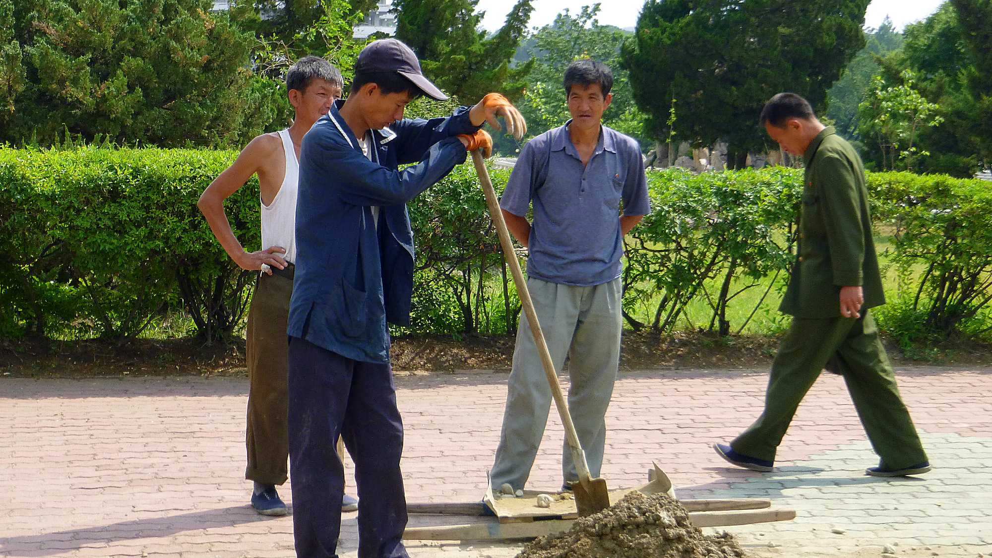 North Korean workers digging a hole in Pyongyang.